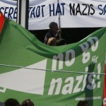 Protesters hold a placard reading: 'Our city is tired of Nazis' during a rally against a neo-Nazi march in Dortmund